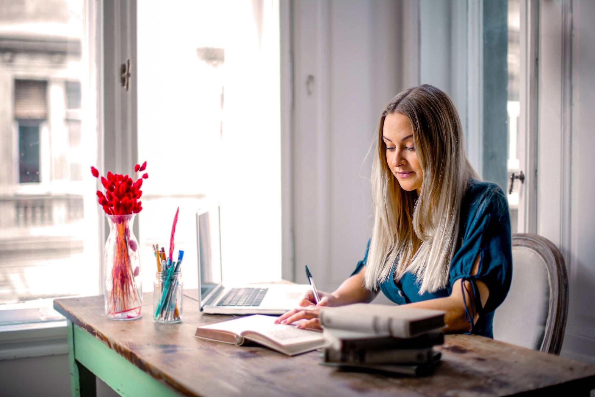woman-in-blue-long-sleeve-shirt-sitting-at-the-table-working-3767388-1